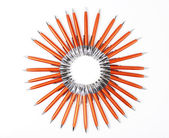 Solar circle of orange pens — Stockfoto