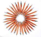 Solar circle of orange pens — Photo