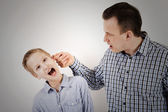 Father punishes son — Stock Photo