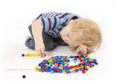 Child plays with a mosaic — Stock Photo