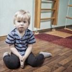 Sad boy in children room — Stock Photo #44610941