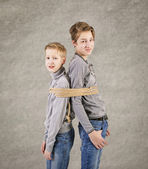 Brothers connected by rope. — Stock Photo