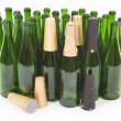 Bottle of champagne and capsules — Stock Photo #44870749
