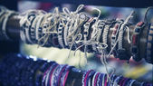 Bracelets and baubles in shop. — Stock Photo
