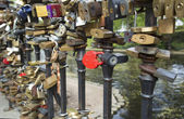 Locks of lovers  on bridge railings — Stock Photo