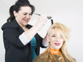Hairdresser dyes hair — Stock Photo