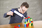 Man glues house from cubes — Stock Photo