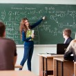 Student at the blackboard - Stock Photo