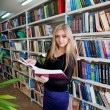Student in the library - Stock Photo