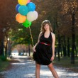 Young girl with balloons - Stock Photo