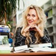 Young beautiful blonde girl in a library — Stock Photo #35303811