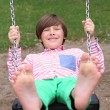 Boy one the swing — Stock Photo