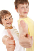 Two little boys pointing ok sign over white — Stock Photo