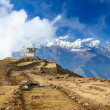 Buddhist stupe or chorten with prayer flags in Himalayas. — Stock Photo #21853139
