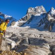 Hiker with a backpack on a glacier — Stock Photo