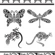 Animal ornaments (butterfly, dragonfly, gecko, kangaroo) - Stock Vector