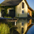 Stock Photo: Old house inverse in lagoon