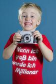 Funny boy with camera — Stock Photo