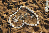 Heart made with pebbles on the beach — Stock Photo