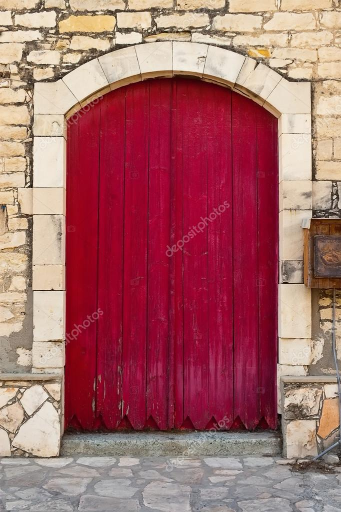 Red Doors Stone : Old red door against stone wall — stock photo aila