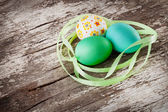 Easter eggs on wood background — Stock Photo