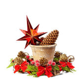 Christmas decoration (stars,pine cone, old pot and Christmas wre — Stock Photo