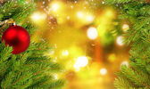 Christmas balls and fir branch on background with shining lights — Foto de Stock