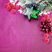Christmas decoration with star on purple background — Stock Photo