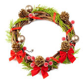 Christmas wreath with red ribbon,pine cones and golden decorati — Stock Photo