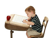 School Boy with Apple and Desk — Stock Photo