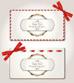 Elegant gift cards with red ribbons — Stock Vector