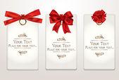 Tarjetas de regalo con diferentes arcos rojas — Vector de stock