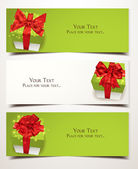 Vector banners with gift boxes ans red ribbons — Stock Vector