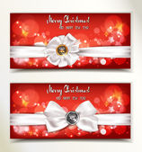 Christmas and New Year red banners with white ribbons — Stock Vector