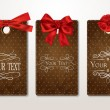 Stok Vektör: Set of vintage gift cards with red bows