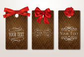 Set of vintage gift cards with red bows — Stok Vektör