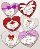 Elegant heart shaped textile cards with silk ribbons — Stock Vector
