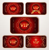 VIP gold cards with calligraphic design elements on the red background — Stock Vector