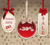Sale Christmas tags with silk bows — Stock Vector