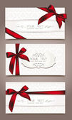 Set of elegant white greeting cards with red ribbons — Vettoriale Stock