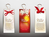 Set of gift cards with silk ribbons — Stock Vector
