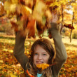 Girl playing in autumn park — Stock Photo
