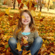 Girl playing in autumn park — Stock Photo #13899161