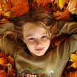 Girl playing in autumn park — Stock Photo #13899164