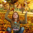 Girl playing in autumn park — Stock Photo #13899168