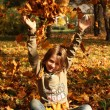 Girl playing in autumn park — Stock Photo #13899172