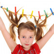 Girl with paperclips in hair — Stock Photo #14344441
