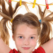 Girl with paperclips in hair — Stock Photo