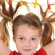 Girl with paperclips in hair — Stock Photo #14344525