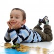 Boy doing jigsaw, puzzle — Stock Photo #15930949